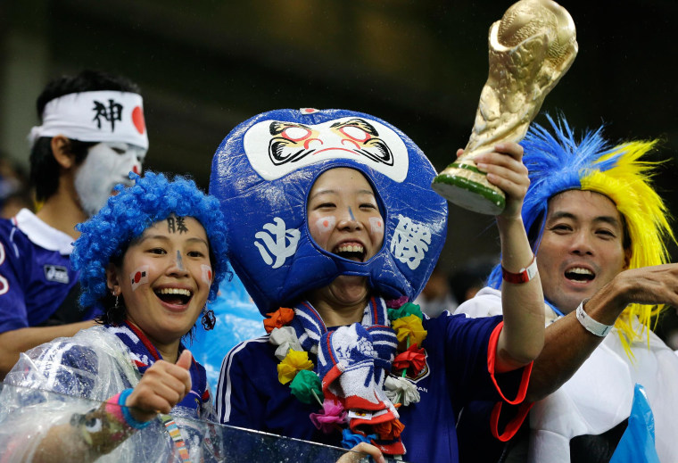 Japanese supporters react before the start of the group C World Cup soccer match between Ivory Coast and Japan at the Arena Pernambuco in Recife, Brazil, on June 14.