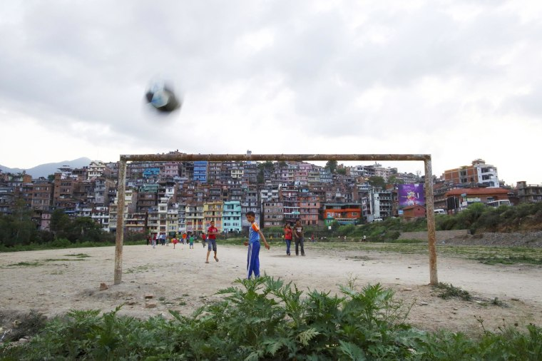 Image: Children play soccer on a playing field in Kirtipur, Kathmandu
