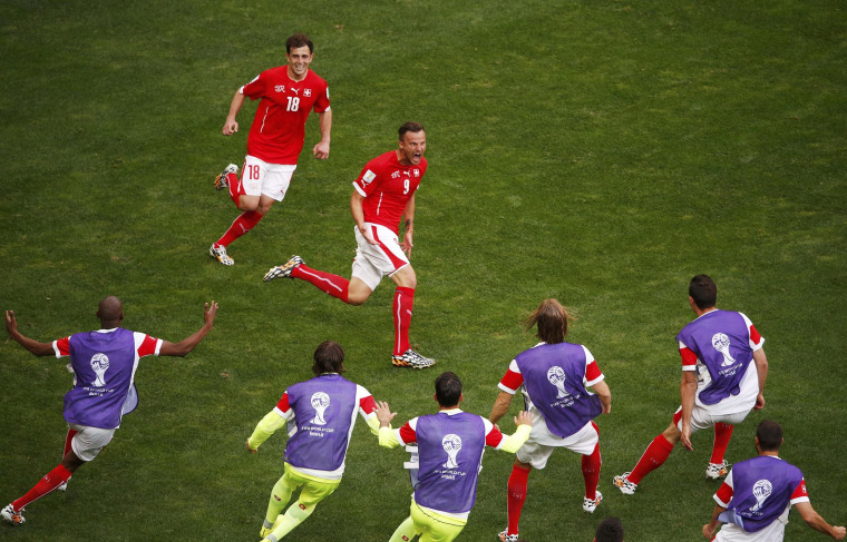 Image: Switzerland's Seferovic celebrates his goal against Ecuador with his teammates