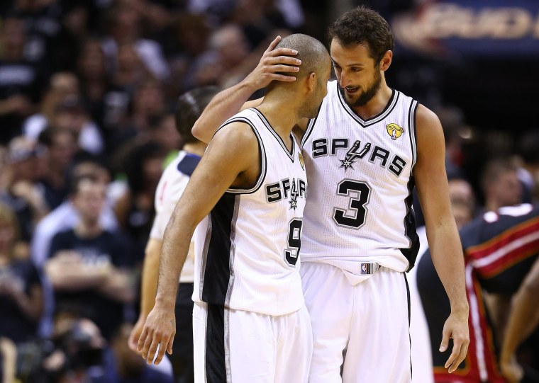 Image: Tony Parker #9 celebrates with Marco Belinelli #3 of the San Antonio Spurs
