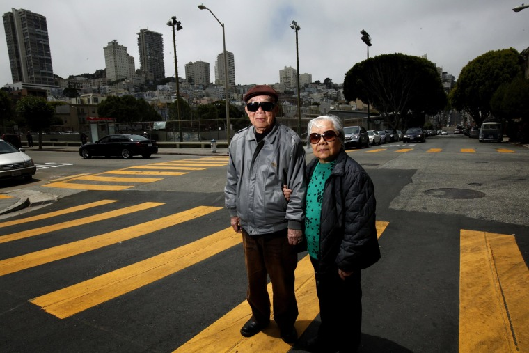 Image: Jian Zhong Li, 92, and his wife Lew Ching Gee Li, 89, are photographed on their block in the North Beach neighborhood in San Francisco, Calif.