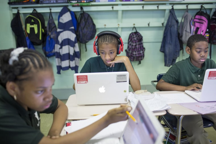 Image: Fifth graders Aiyanah Tyler, Trinity Coker and Hakim Walker work with 13-inch Apple MacBooks from late 2009 at a Philadelphia school