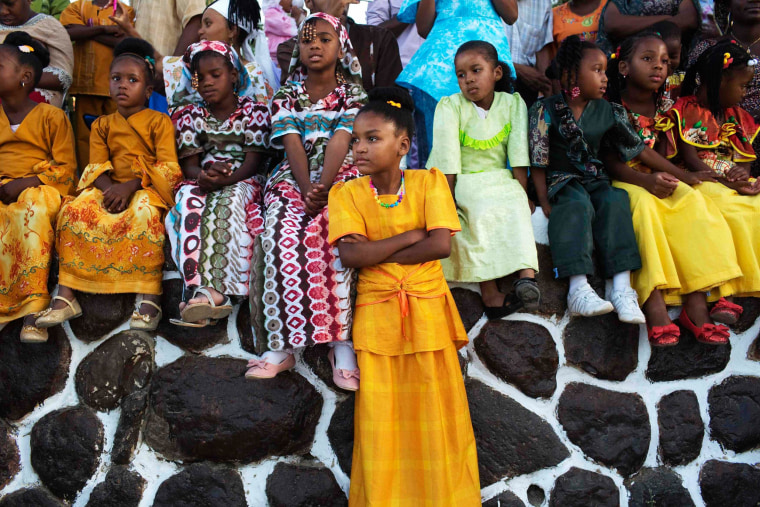 Image: Members of the African Hebrew Israelite community watch a dance as they take part in celebrations for the holiday of Shavuot in Dimona
