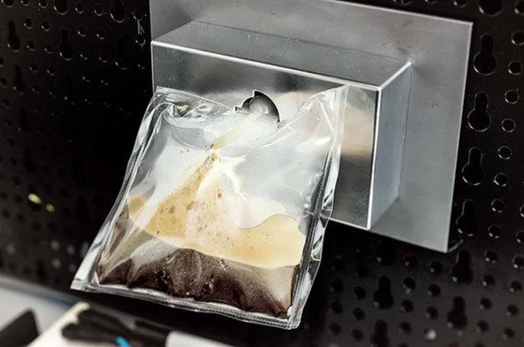 """A prototype of Lavazza's and Argotec's """"ISSpresso"""" dispenses a freshly-brewed Italian espresso just as the final coffee machine will do so onboard the International Space Station."""