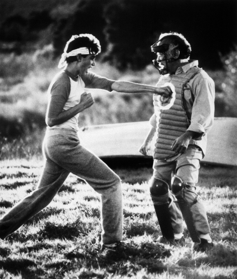 "Image: Ralph Macchio learns physical and emotional discipline from his mentor, Noriyuki ""Pat"" Morita, in ""The Karate Kid"", 1984."
