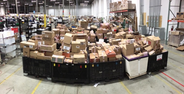 Boxes of used devices await unpacking at a NextWorth processing warehouse.