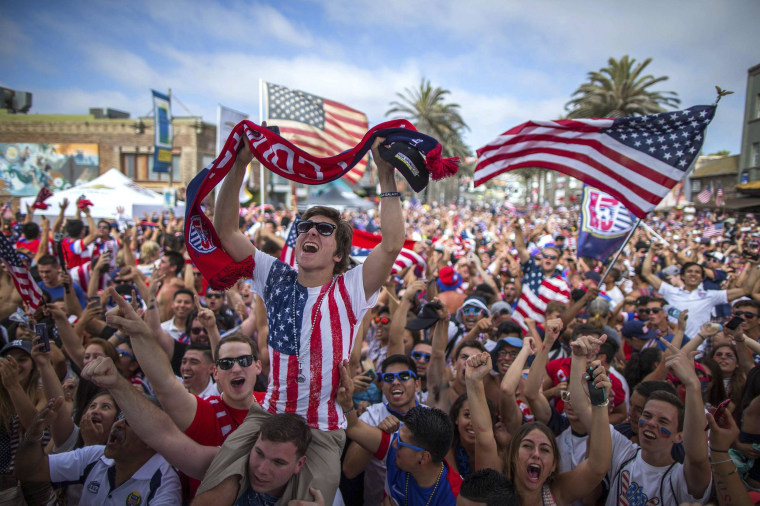 Image: Fans cheer after the U.S. scored a second goal during a match against Ghana