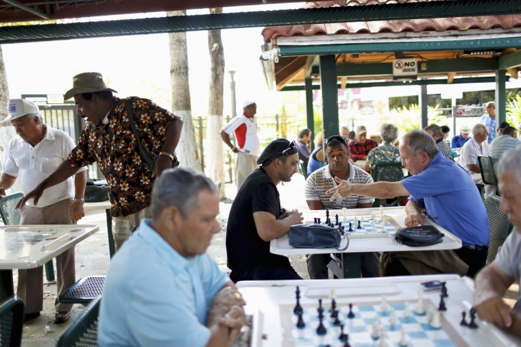 Local residents gather to play dominos at Maximo Gomez Park in the Little Havana district of Miami, Florida May 17, 2014. The park, named after a famous Cuban revolutionary has been a favorite gathering spot in Miami for Cuban Americans. Recent polls show more Cuban Americans, especially younger ones, are more willing to support increased U.S. engagement with Cuba.