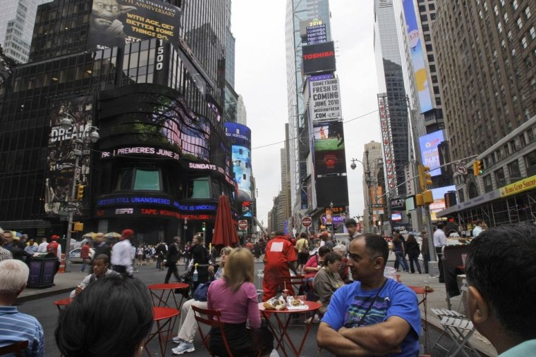 Image: People frequent pedestrian plazas in Times Square/Herald Square in New York.