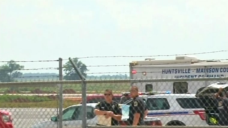 Image: First responders on the scene of a plane crash in Hunstville, Ala.