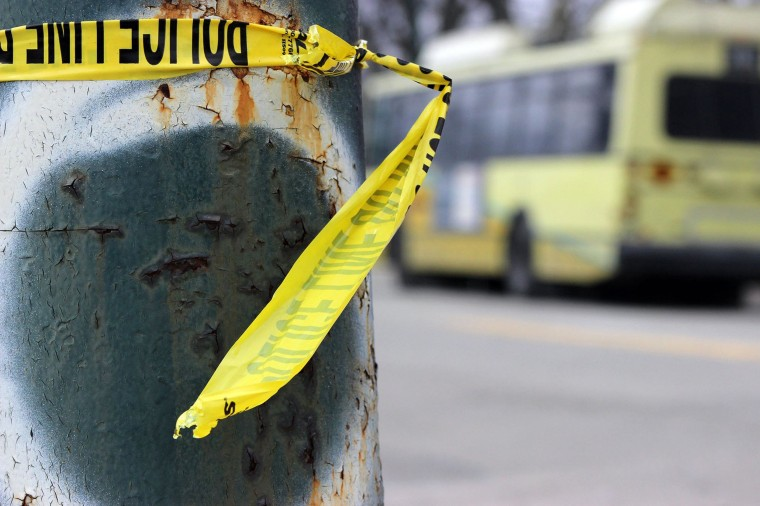 Image: Police tape is wrapped around a pole near the shooting scene where an RTA bus driver was attacked and shot in Dayton, Ohio