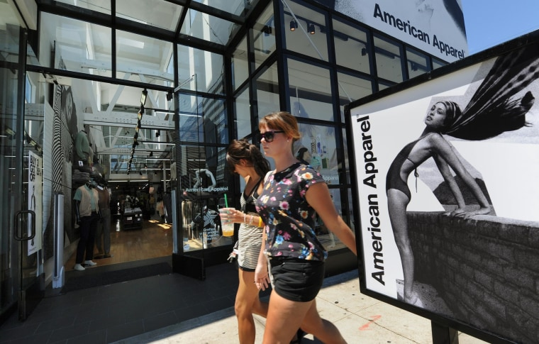 Shoppers walk past an American Apparel clothing store in West Hollywood, California on August 18, 2010.