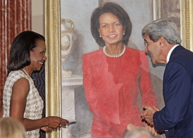 Image: Secretary of State John Kerry smiles with former US Secretary of State Condoleezza Rice