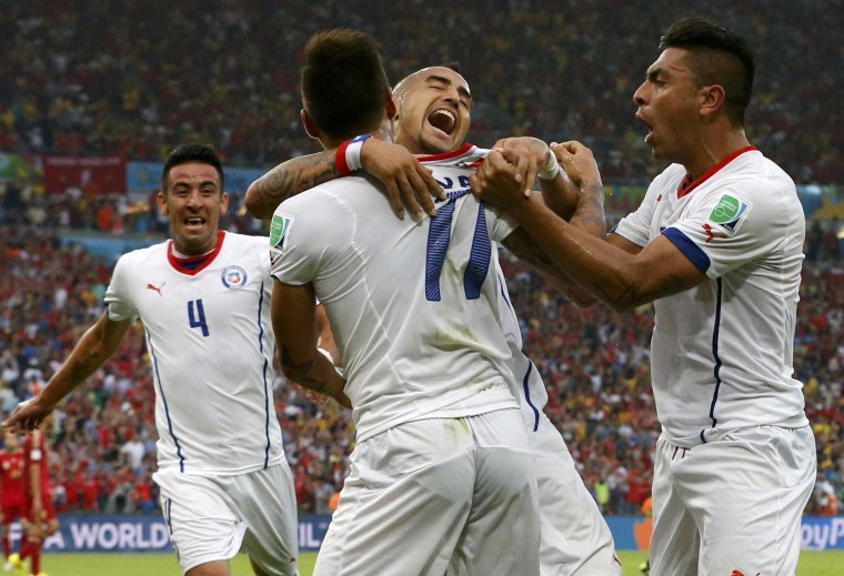 Image: Chile's Mauricio Isla, Eduardo Vargas, Arturo Vidal and Gonzalo Jara celebrate after their first goal during their 2014 World Cup Group B soccer match against Spain at the Maracana stadium in Rio de Janeiro