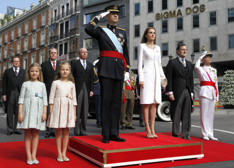 Image: Princess Sofia, Princess Leonor of Asturias, King Felipe VI of Spain, Queen Letizia of Spain, Prime Minister Mariano Rajoy and General Admiral Fernando García Sanchez watch a parade of Civil Guard at the Congress of Deputies prior to the King's off