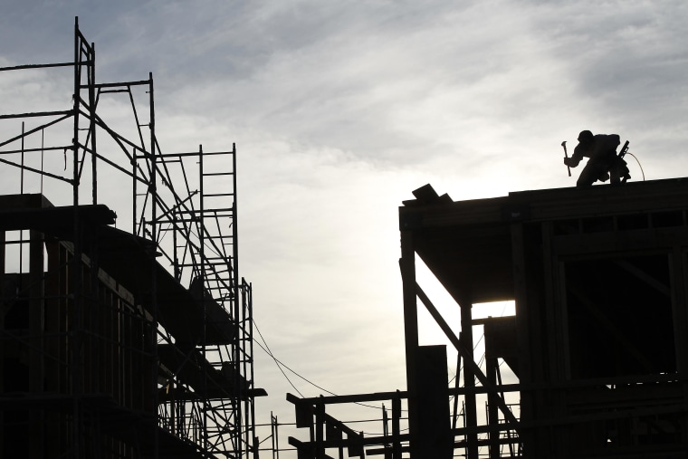 Image: File photo of a worker on the roof of a building under construction in Los Angeles