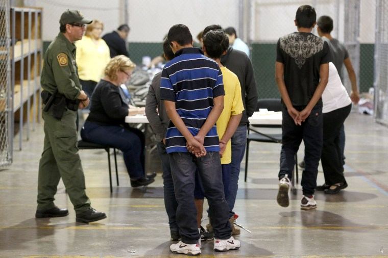 Image: Familes and Children Held In U.S. Customs and Border Protection Processing Facility