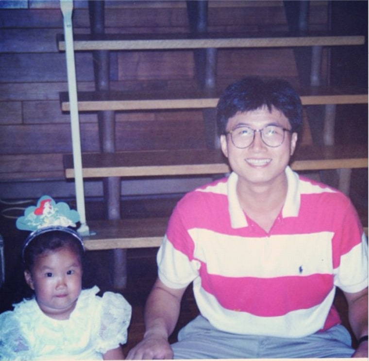 Jinna Yang as a toddler, with her father, Jay Kwon Yang.