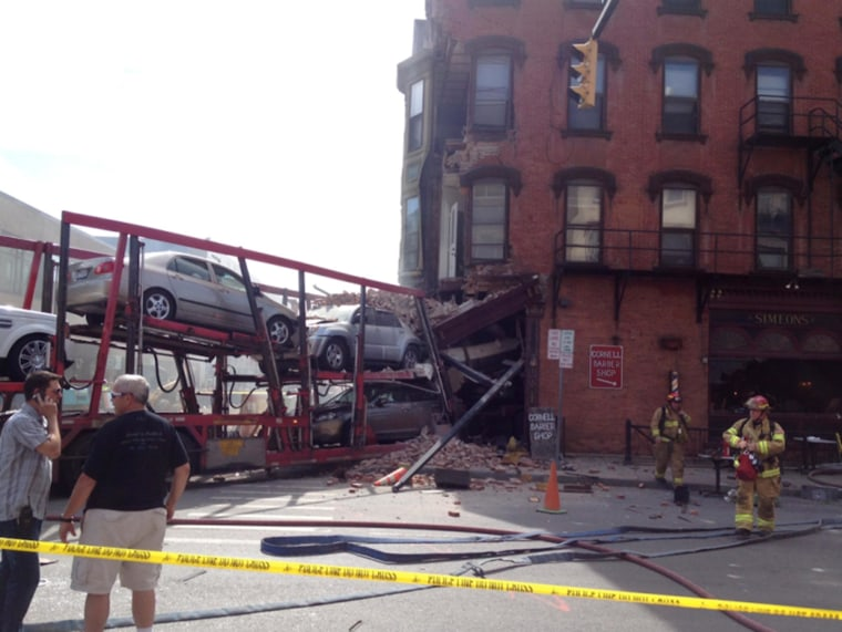 Image: The scene of an accident after a tractor trailer slammed into a restaurant in Ithaca, N.Y.
