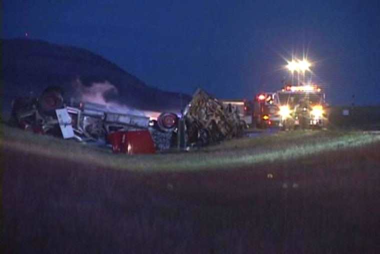 Image: The scene of a fatal crash between a fire truck and pickup truck on a Montana road