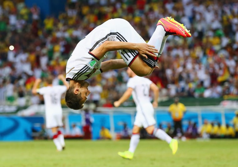 Image: Miroslav Klose of Germany does a flip in celebration of scoring his team's second goal during the 2014 FIFA World Cup Brazil Group G match between Germany and Ghana