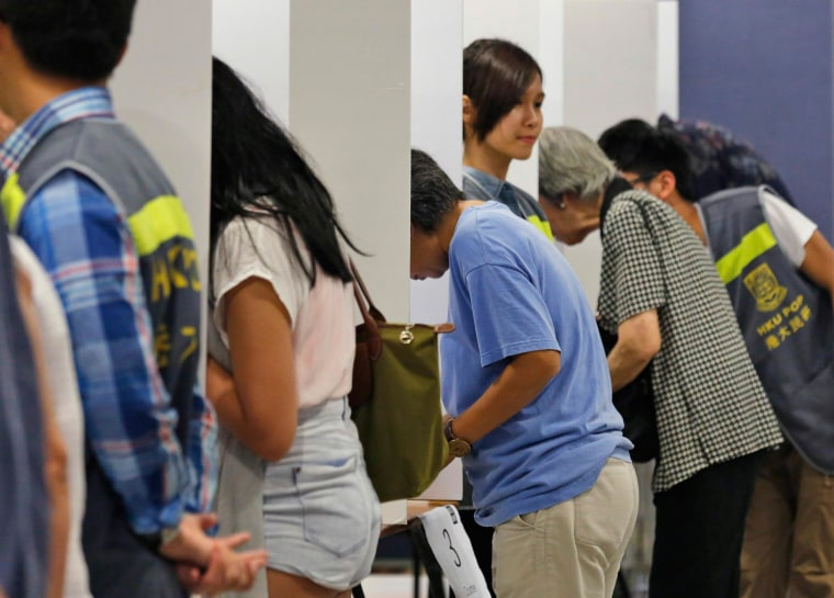 Image: People vote in a polling station for an unofficial referendum on democratic reform in Hong Kong
