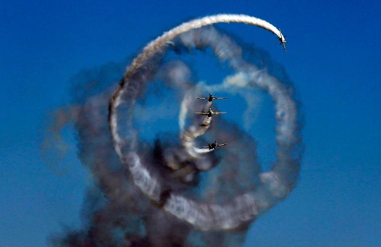 Image: Aerobatic Yakkers team perform on YAK-52 airplanes during Bucharest International Air Show at Baneasa airport