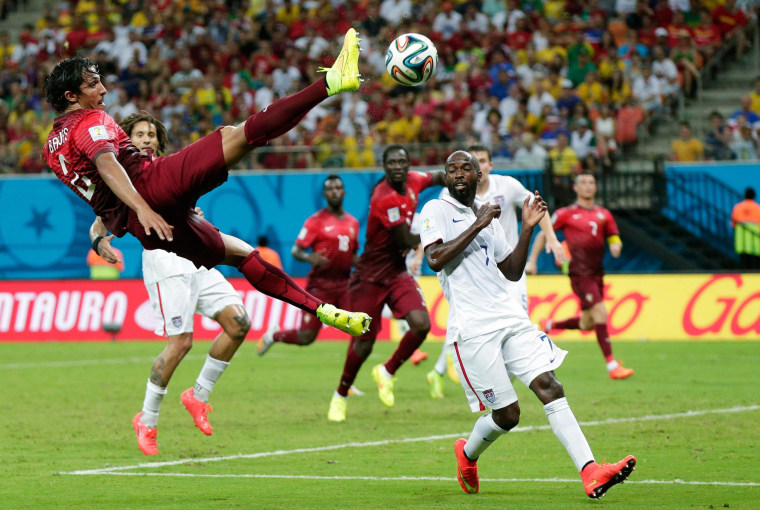 Image: Portugal's Bruno Alves kicks the ball above United States' DaMarcus Beasley