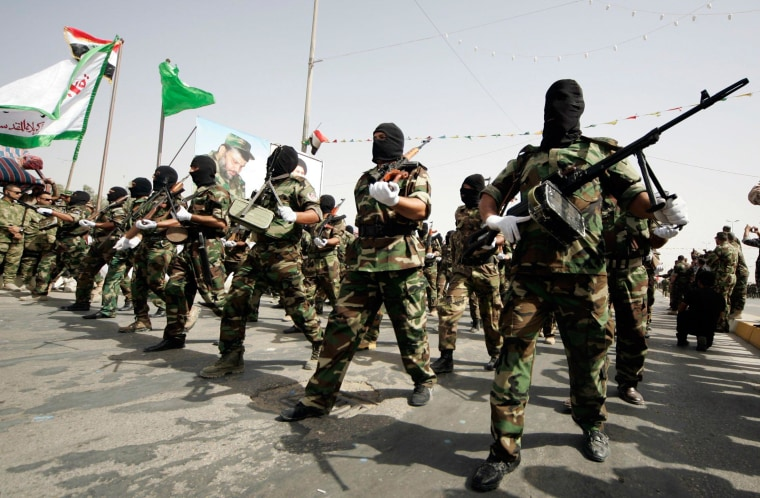 Image: Mehdi Army fighters loyal to Shi'ite cleric Moqtada al-Sadr march during military-style training in Najaf