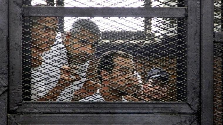 Image: Peter Greste, Mohamed Fahmy, Baher Mohammed