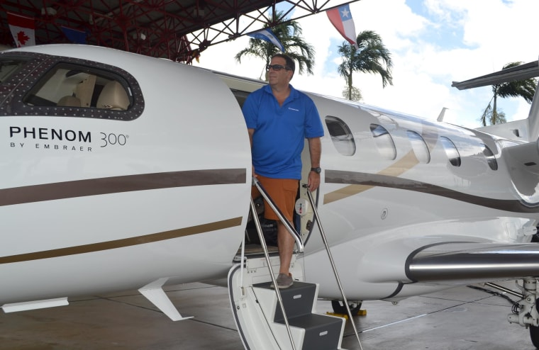 David Mendal, who owns several luxury travel companies, is shown next to his jet at the revamped Opa-locka Executive Airport.  An airport with a storied history, it had fallen into disrepair until the increasing numbers of wealthy Latin Americans and other entrepreneurs and jetsetters helped boost demand for the airport.
