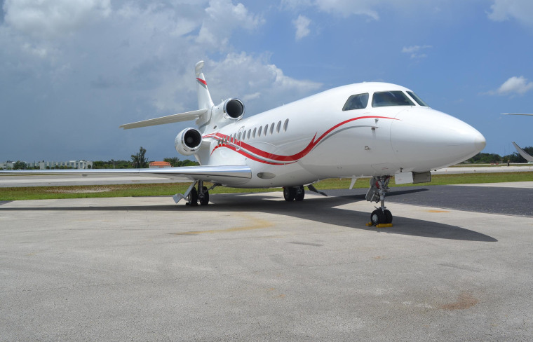 A Falcon 7X, worth around $55 million, parked outside the terminal of Miami Executive Aviation at the Opa-locka Executive Airport.