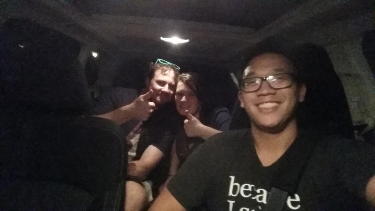 Image: Alex Sheen poses with a couple he drove home from a bar in Lakewood, Ohio Saturday night.