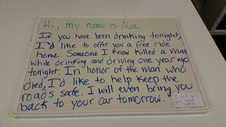 Image: A handwritten sign explains Alex Sheen's mission to drive strangers home from a bar for free in Lakewood, Ohio Saturday night.