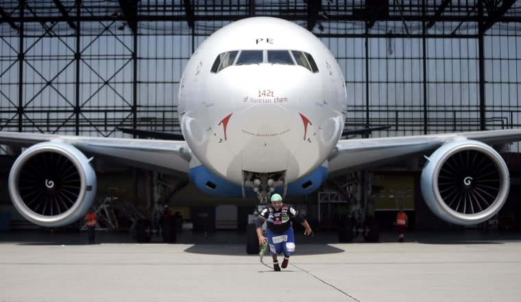 Image: Austrian extreme athlete Franz Muellner performed his world record attempt of pulling a Boeing 777 out of a hangar at the airport Vienna-Schwechat, Austria, on June 23. Muellner successfully pulled out the aircraft from the hangar.