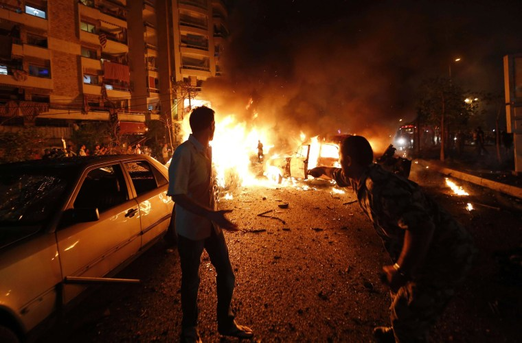 Image: The site of a car bomb attack in the mainly Shiite populated Shayyah neighborhood of a Beirut