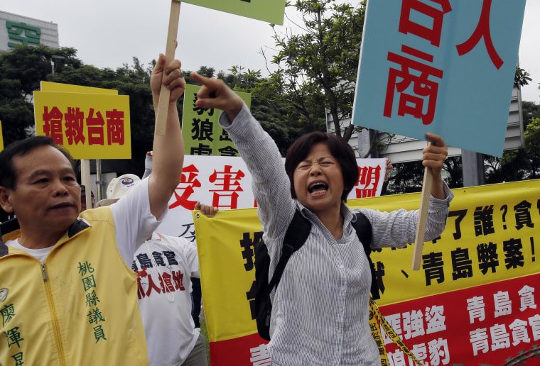 Image: Anti-China demonstrators protest the arrival of Zhang Zhijun