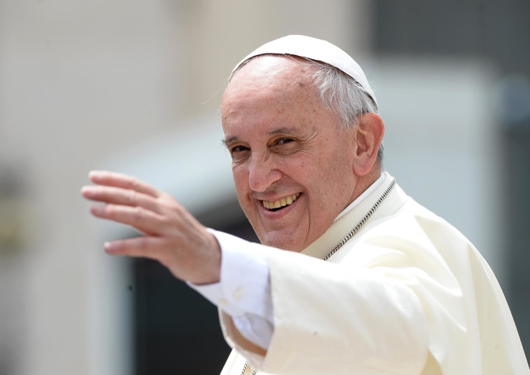 Pope Francis greets the crowd at the end of his general audience at St. Peter's square on June 25 at the Vatican.
