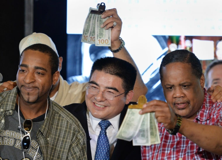Image: US-CHINA-CHEN-GUANGBIAO-HOMELESS-LUNCH