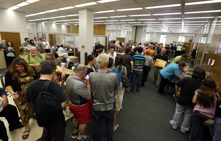 Image: Hundreds of same sex couples line up to apply for marriage licenses at the Marion County Clerks office in Indianapolis