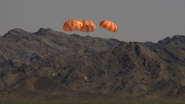 A test version of NASA's Orion spacecraft descends under its three main parachutes above the U.S. Army's Yuma Proving Ground in Arizona on Wednesday in the agency's most difficult test of the parachute system's performance