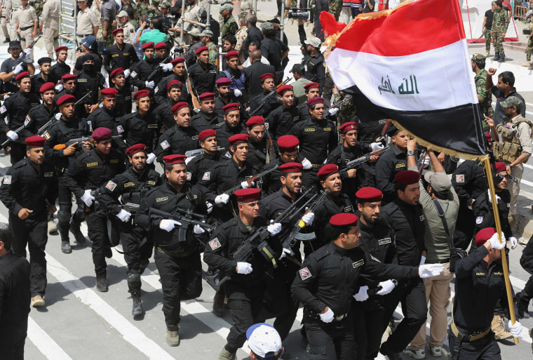 "Volunteers of the newly formed ""Peace Brigades"" participate in a parade in the Shiite stronghold of Sadr City, Baghdad, Iraq, Saturday, June 21, 2014."