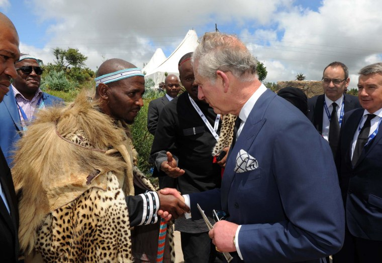 King of the Xhosa tribe Zwelonke Sigcau meets Britain's Prince Charles at Nelson Mandela's burial service, in Qunu, South Africa, Dec. 15, 2013.