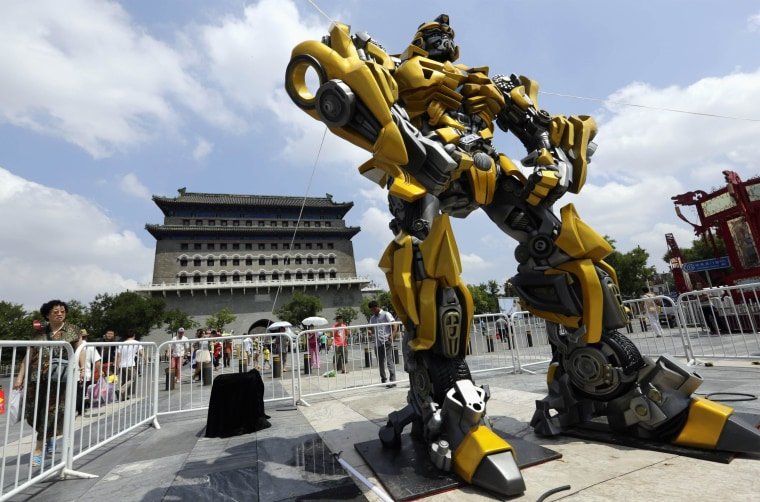 Image: A model of the Transformers character Bumblebee is displayed in front of Qianmen Gate in central Beijing