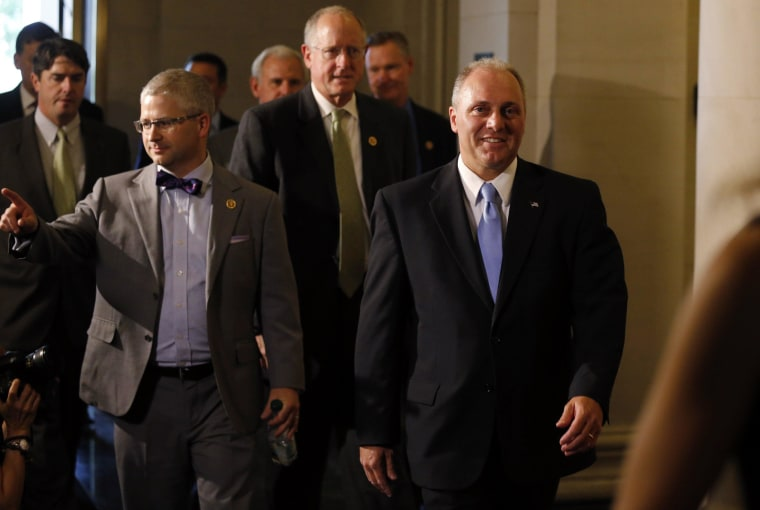 Image: House Majority Whip candidate Scalise arrives with Rep. McHenry for House Republican leadership elections in the Longworth House Office Building on Capitol Hill in Washington