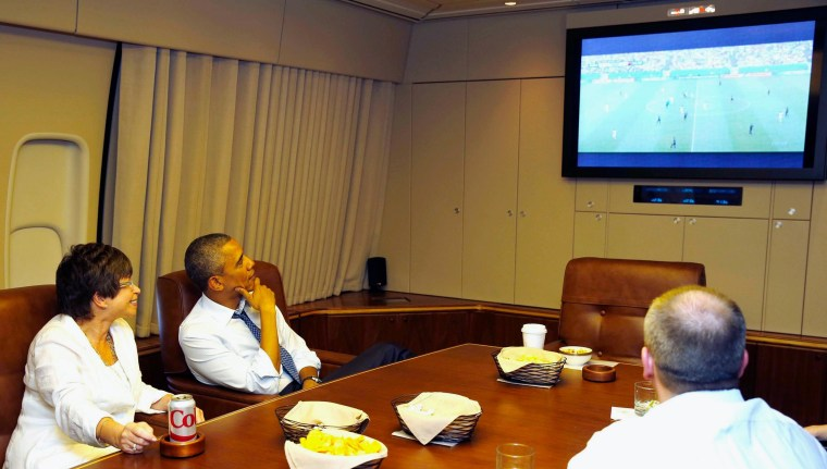 Image: U.S. President Obama and his senior advisor Jarrett watch the U.S. and Germany World Cup soccer match while aboard Air Force One