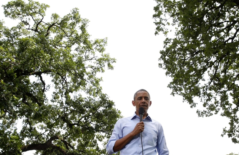 Image: U.S. President Barack Obama thinks before speaking in a town hall meeting at Minnehaha Park in Minneapolis