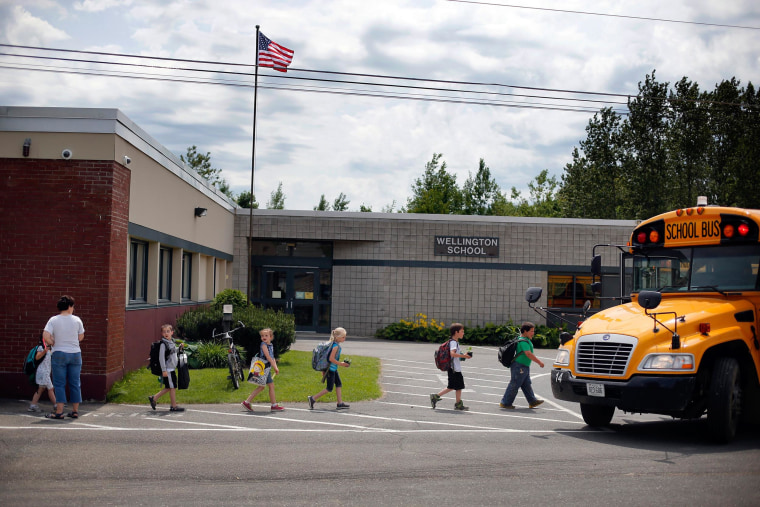Students leave for home on the final day of school at the Wellington public school in Monticello, Maine, Tuesday, June 17.