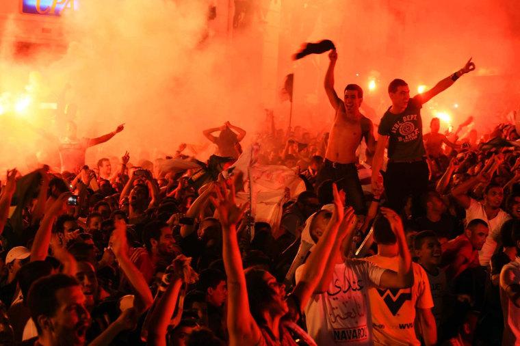 Image: Algerian fans celebrate in Algiers