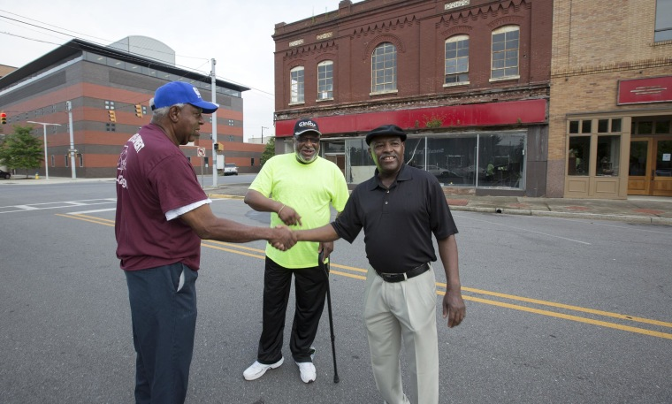 Herman Williams, Albert Shade and Desmond Wright  stand outside of the now-closed McLellan's department store almost 50 years after they staged a sit-in there at the whites-only lunch counter.